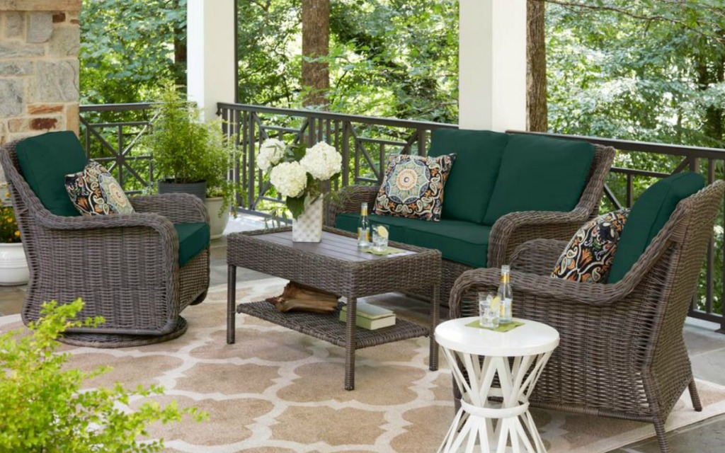 green cushions with a wicker patio set on a patio