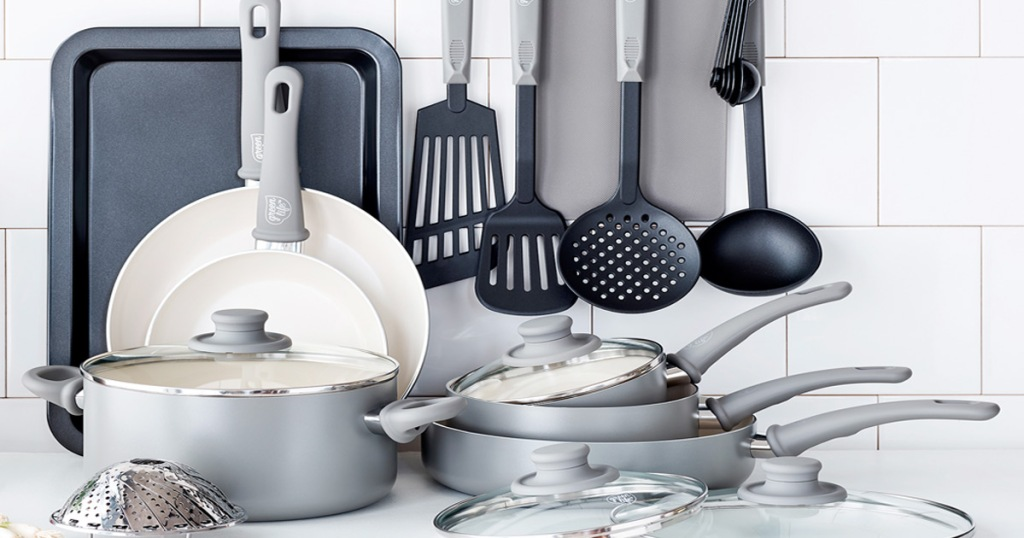 18-piece grey colored cookware set with pots, pans, lids, baking sheet, and cooking utensils