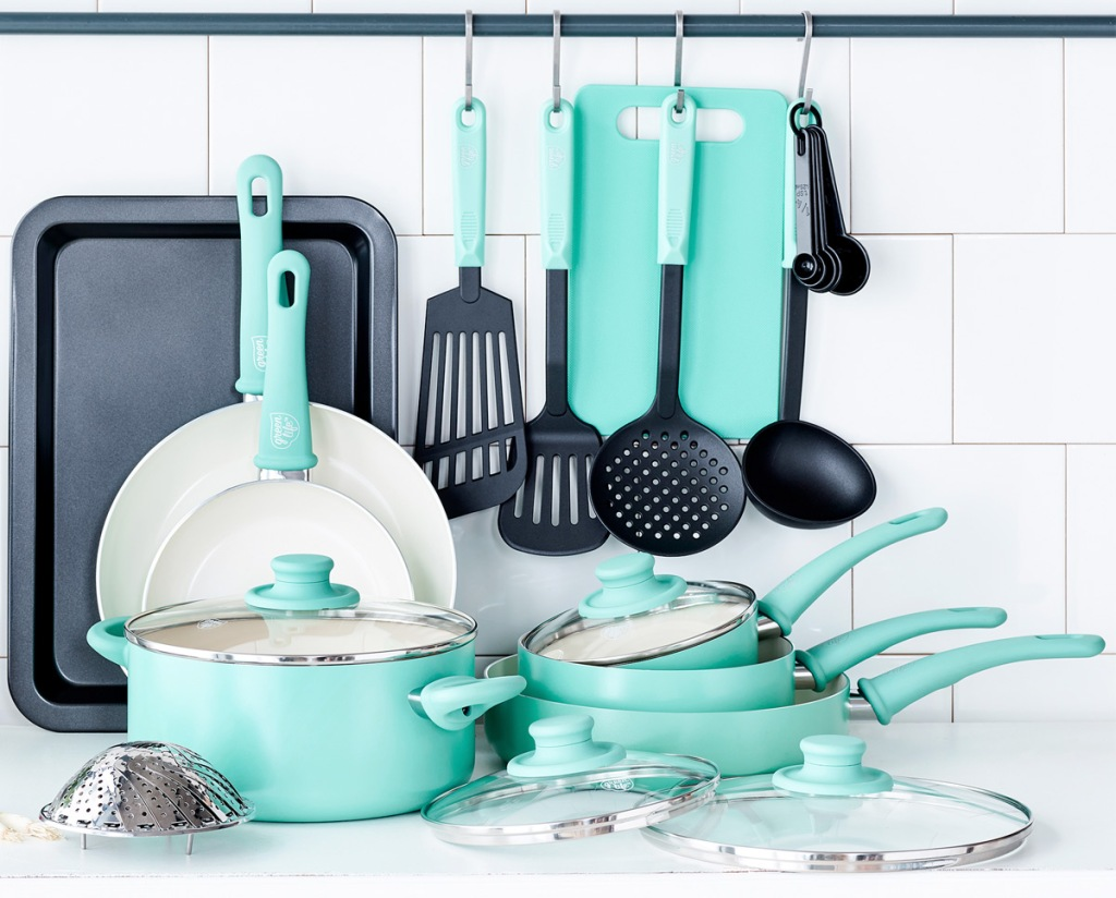 18-piece tortoise colored cookware set with pots, pans, lids, baking sheet, and cooking utensils