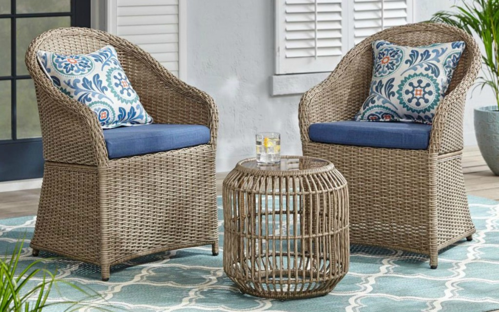 Hampton Bay furniture in wicker and blue with floral pillows