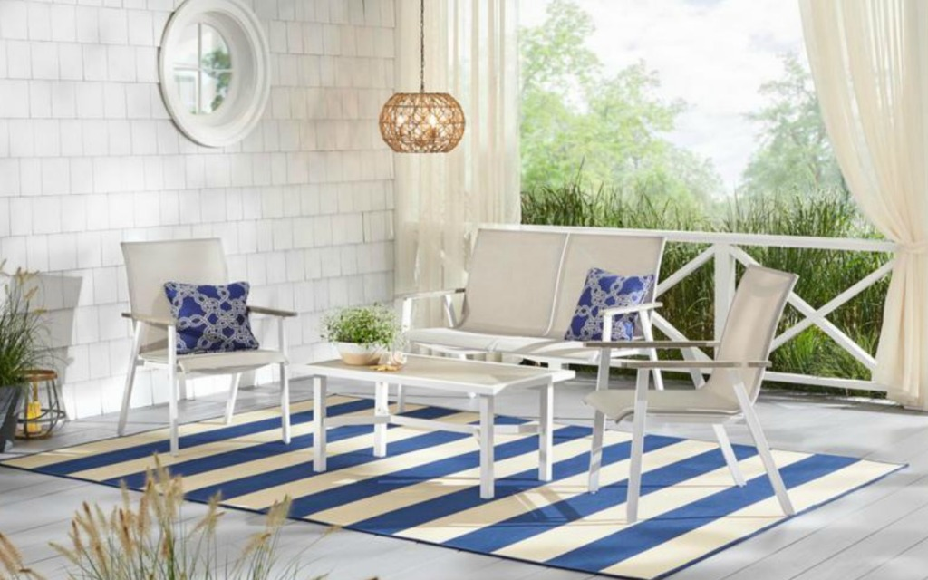 blue and white rug with patio furniture on it