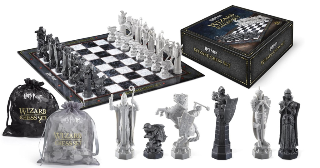 Harry Potter Chess Set with chess pieces in front, board and box