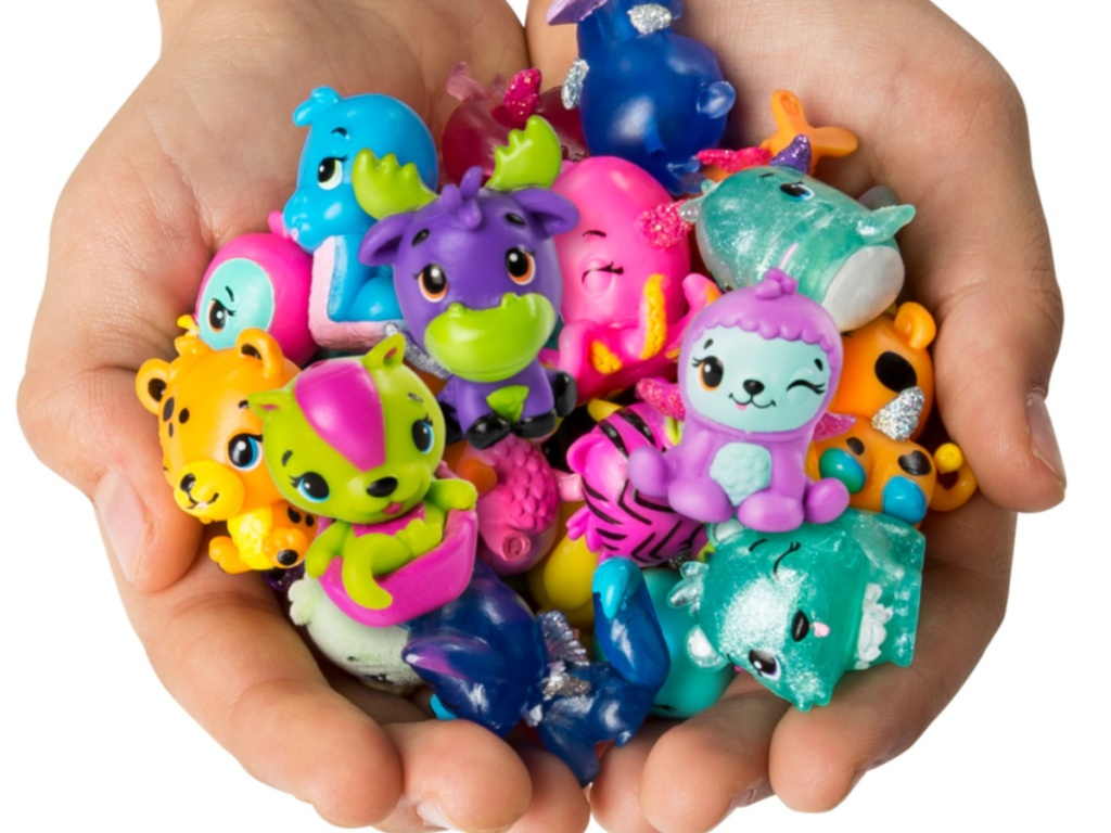 hands holding various animal toys