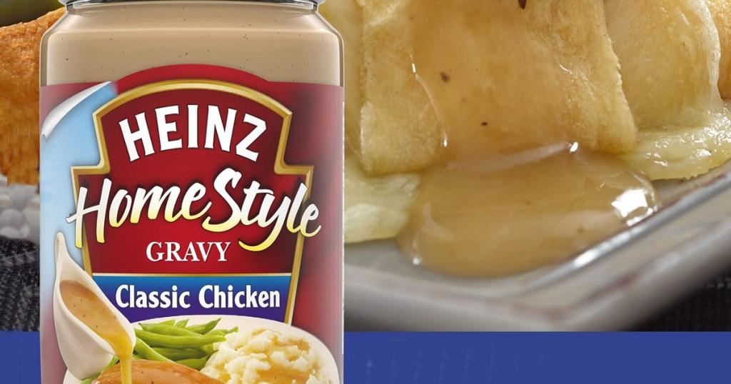 jar of heinz classic chicken gravy sitting front of dinner roll with gravy on it