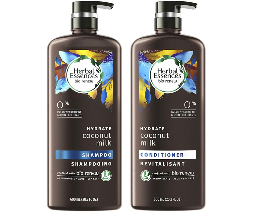 two large brown bottles with pump tops of herbal essences coconut milk shampoo and conditioner