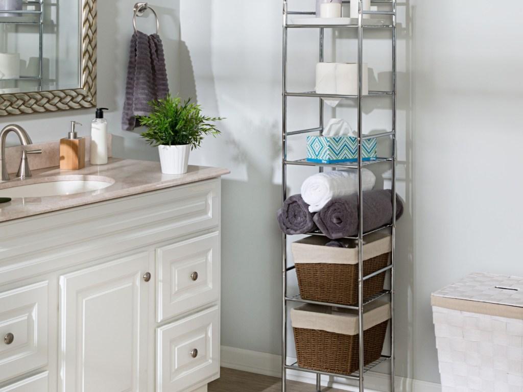 tall chrome bathroom storage stand in bathroom