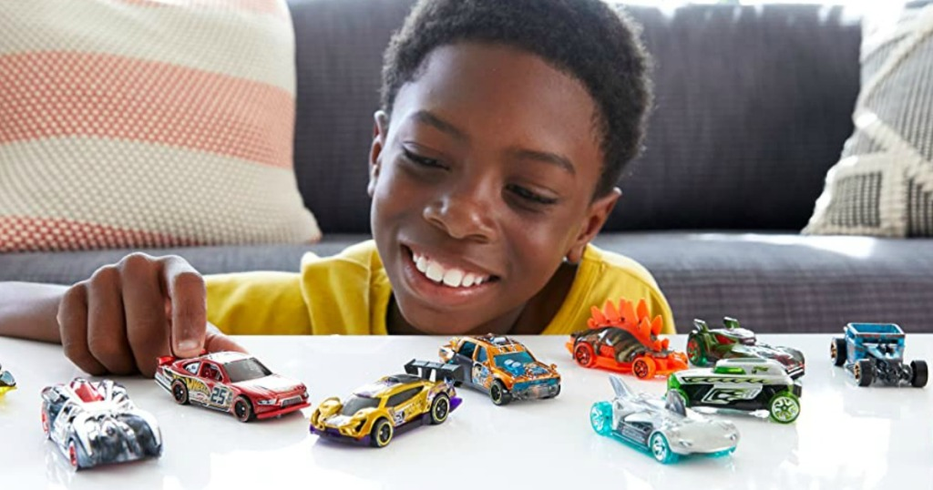 boy playing with Hot Wheels cars