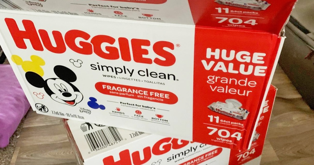 white and red boxes of huggies simply clean baby wipes stacked on top of each other