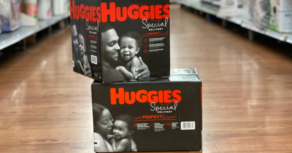two boxes Huggies Special Delivery Boxed Diapers sitting on the store floor
