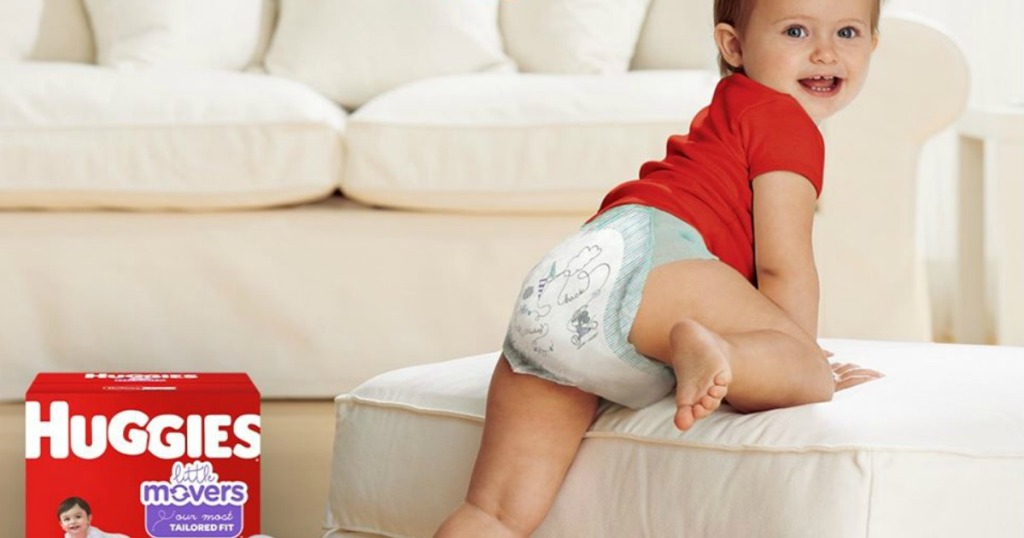baby in a diaper climbing on the couch