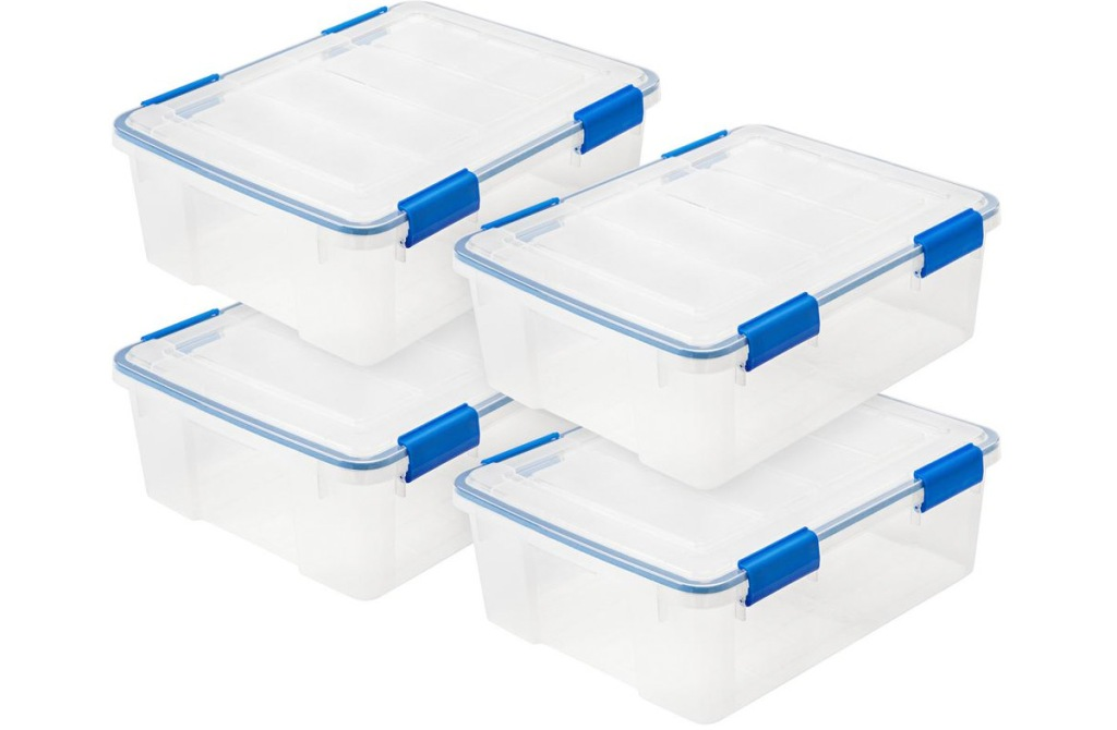set of four clear storage containers with blue latching lids