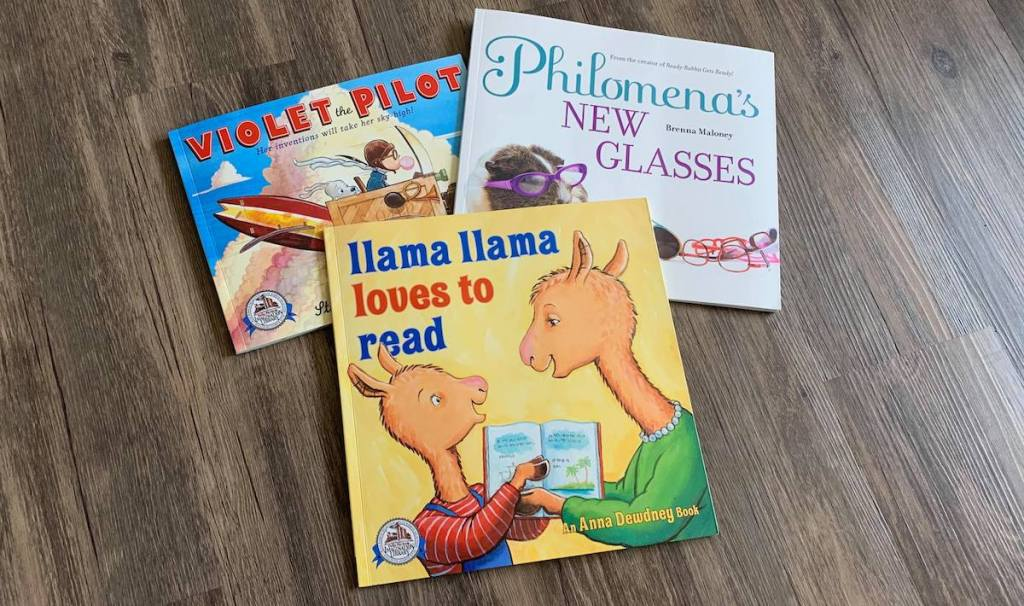 three books sitting on floor