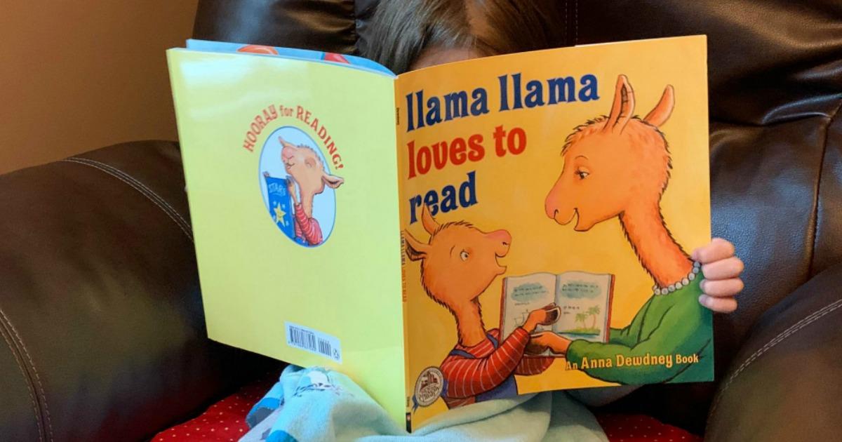 child holding llama llama book