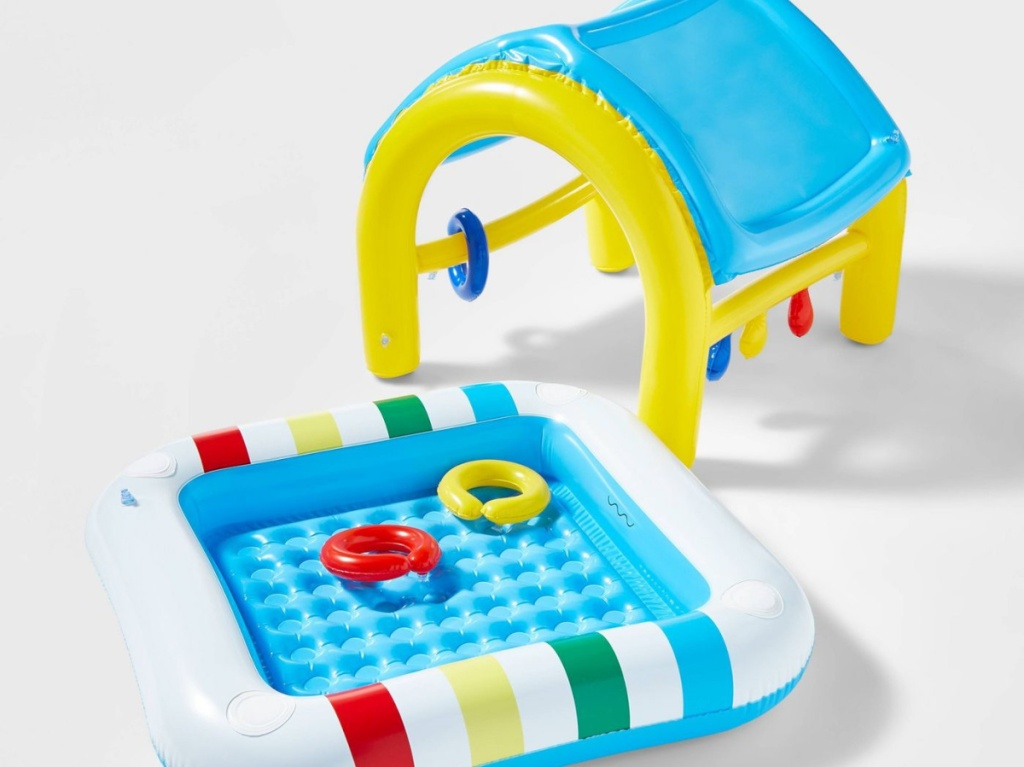 inflatable baby pool and pool top with two ring toys in pool
