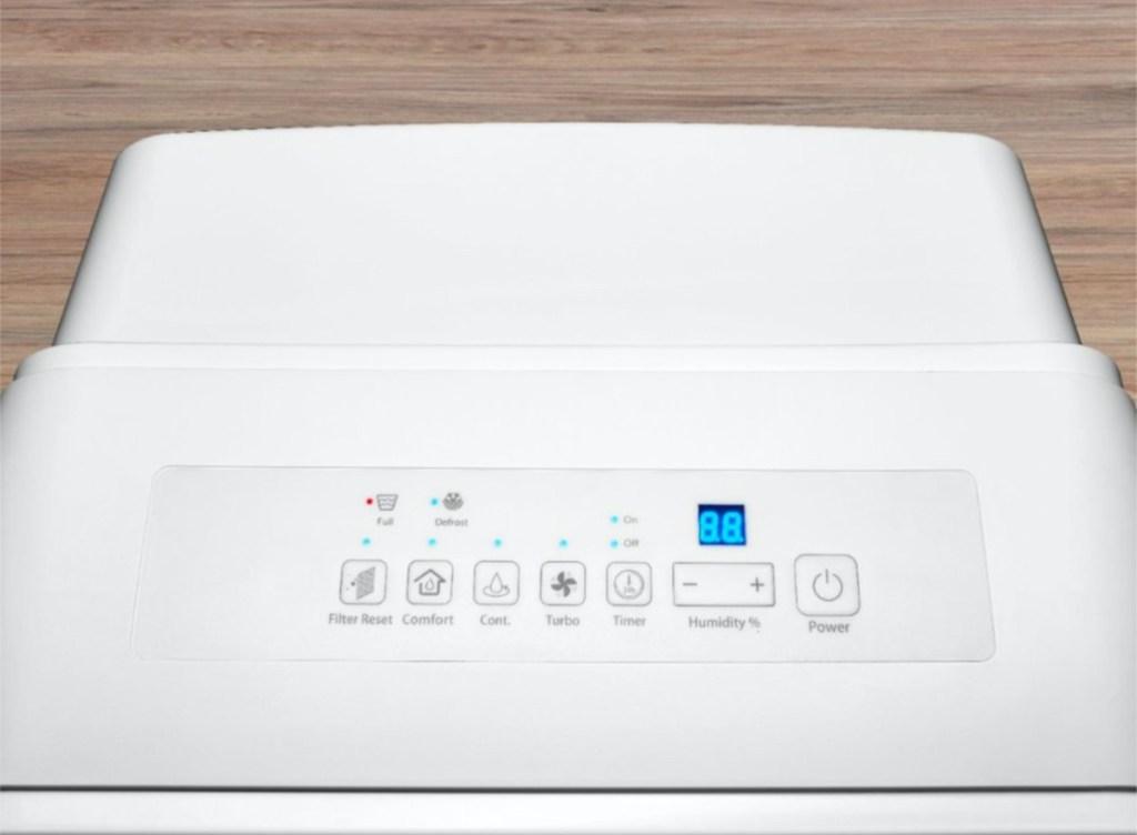 button on white dehumidifier