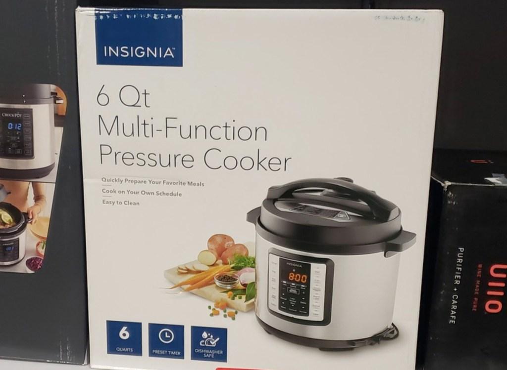 white box for the insignia brand 6-quart multi function pressure cooker on store shelf