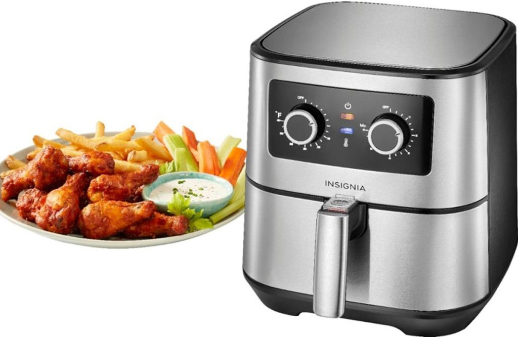 stainless steel and black air fryer with two adjustment knobs next to a plate of chicken wings