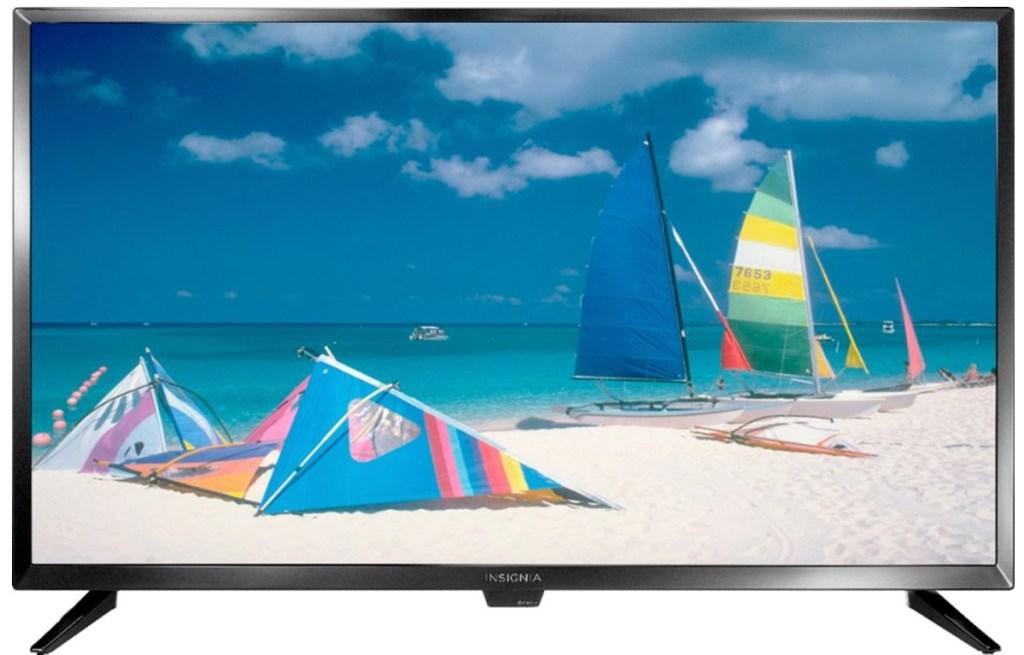 black Insignia TV with beach scene on screen