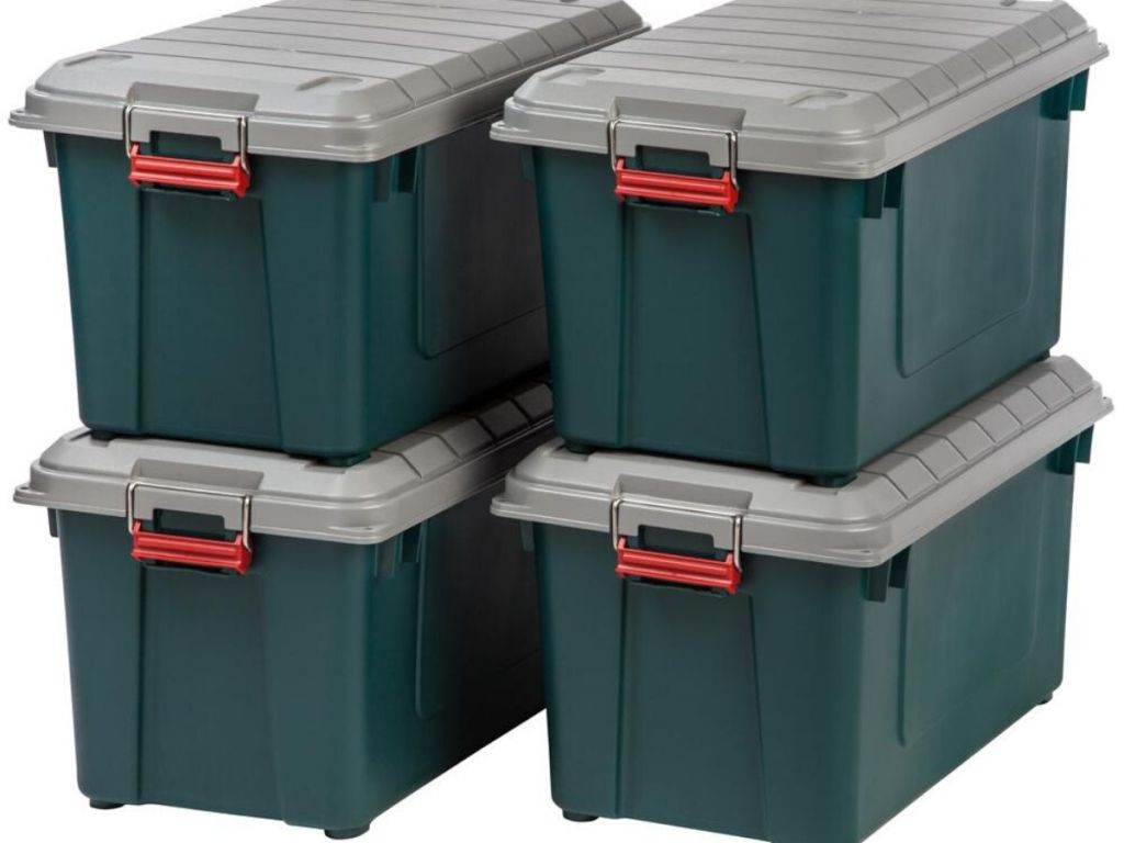 four large heavy duty storage containers