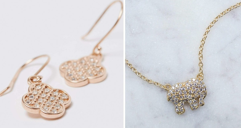 gold clover shaped earrings and gold crystal covered elephant shape necklace