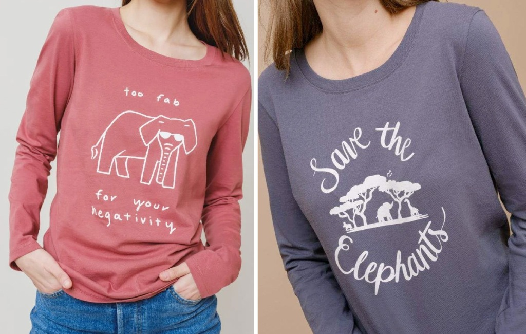 two women modeling red and blue long sleeve shirts with white elephant graphics