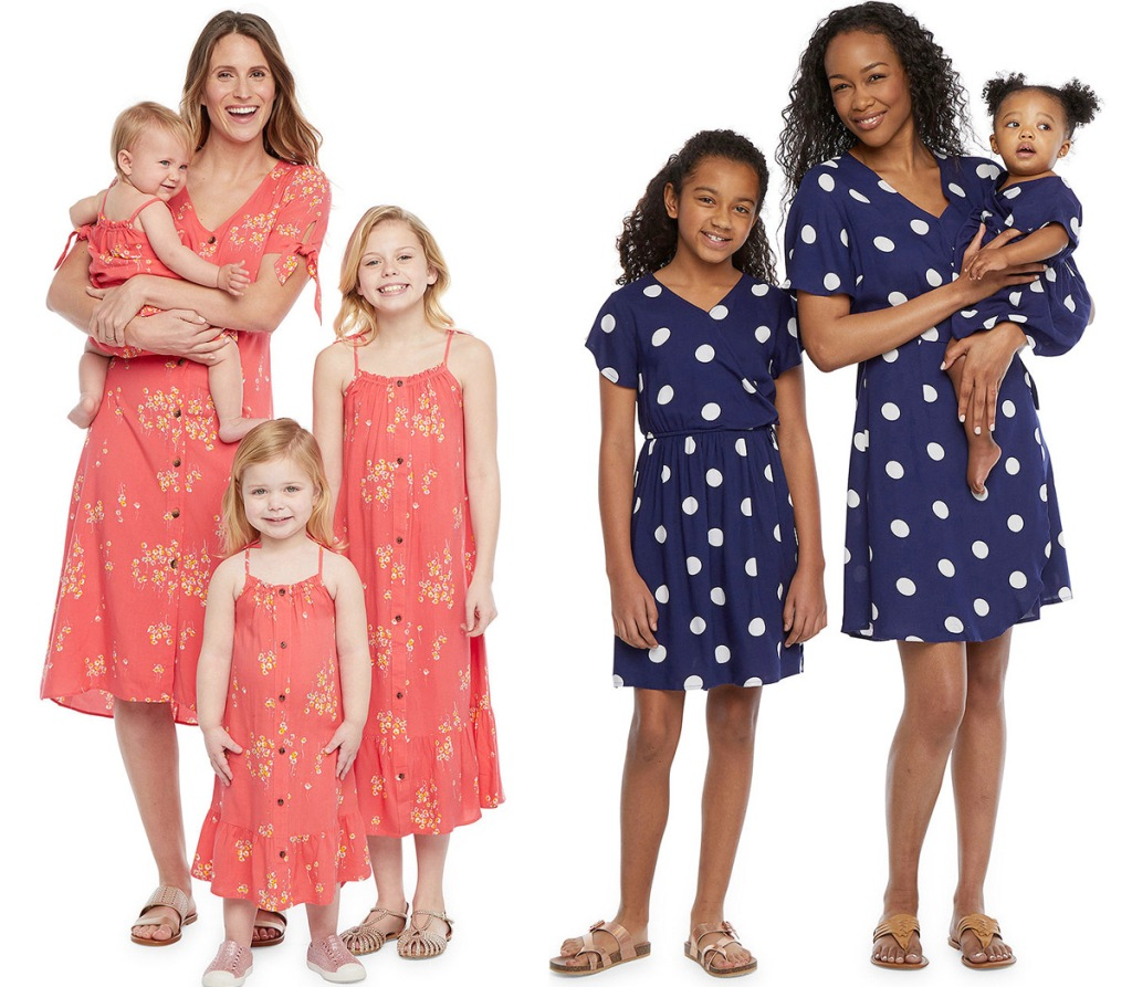 two sets of mothers with their daughters wearing matching dresses in pink floral and navy with white polka dots patterns