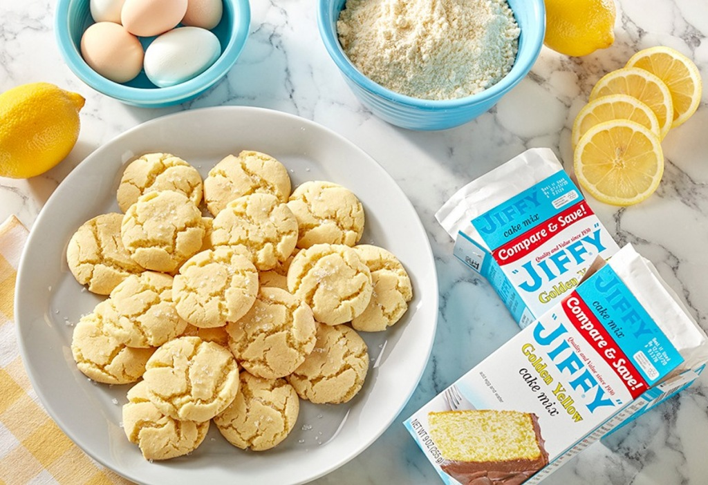 plate of cookies next to lemons and two boxes of jiffy yellow cake mix
