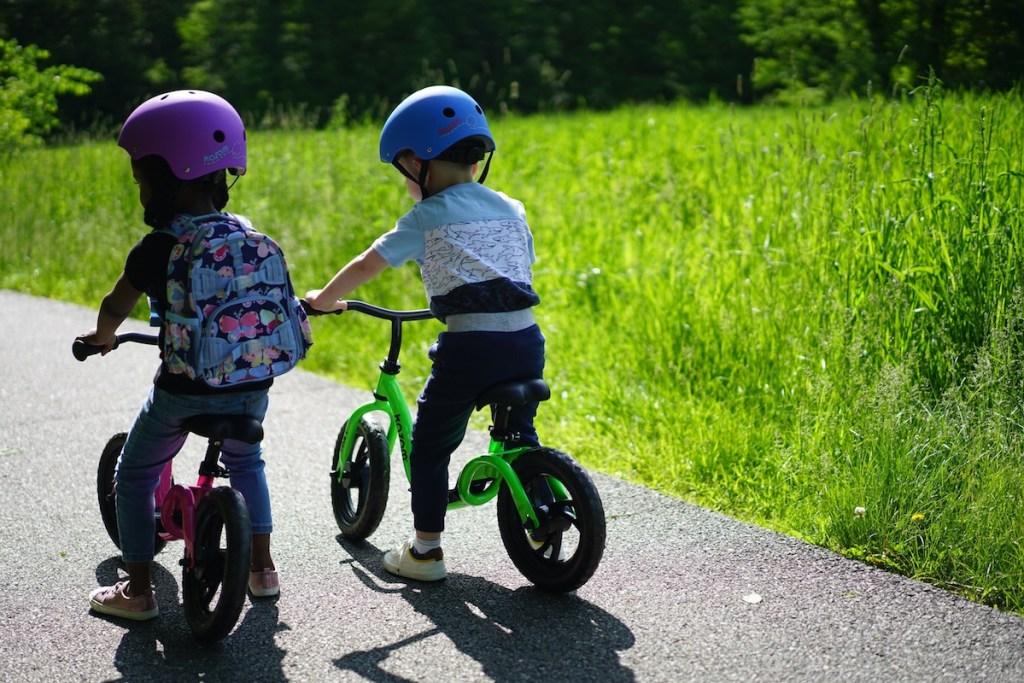 Kids playing on balance bikes
