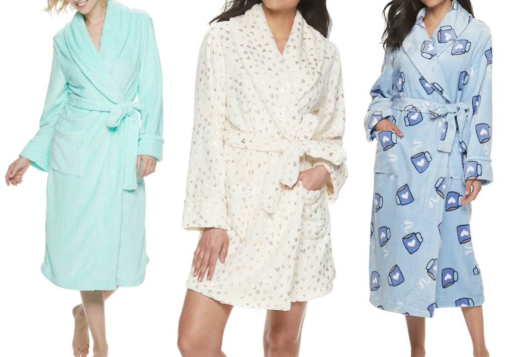 three women modeling bathrobes in mint green, white with gold stars, and blue with coffee mugs print