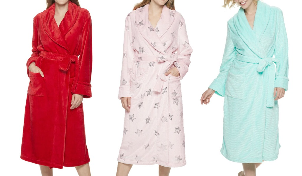 three women modeling bath robes in red, pink with stars, and mint green colors