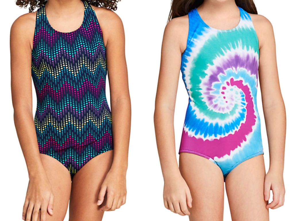 girl in multi-colored dark one-piece swimsuit and girl in tie-dye one-piece swimsuit