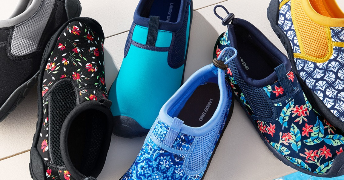 various color and patterned water shoes on white deck