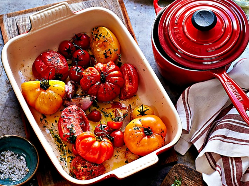 roasted veggies in a baking dish and sauce pot with lid