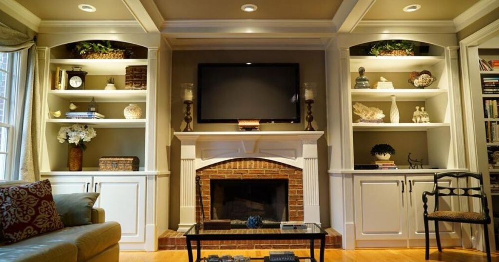 living room with fireplace and mantle with recessed lighting in ceiling