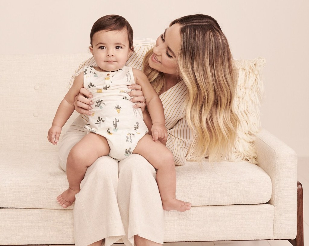 woman holding baby wearing Little Co by Lauren Conrad Baby Body Suit