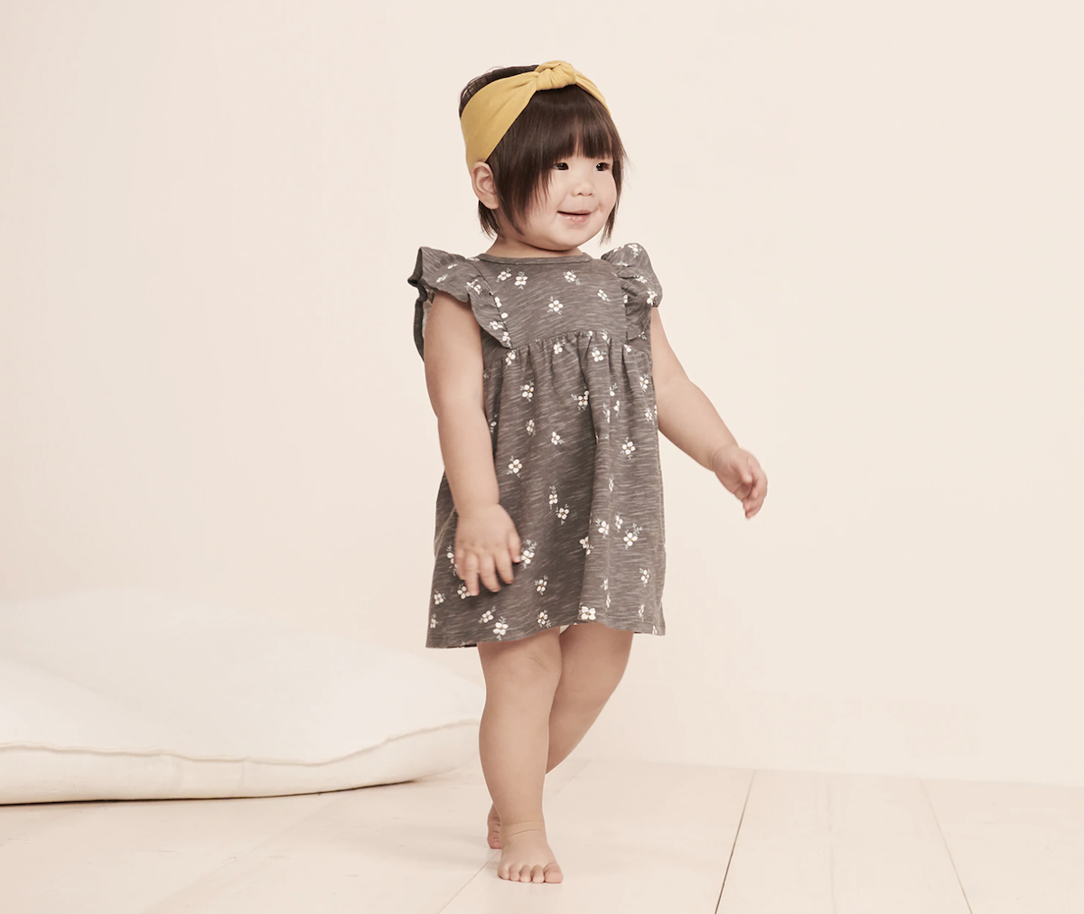 baby wearing Little Co. by Lauren Conrad Ruffle Dress & Headband Set in grey and yellow