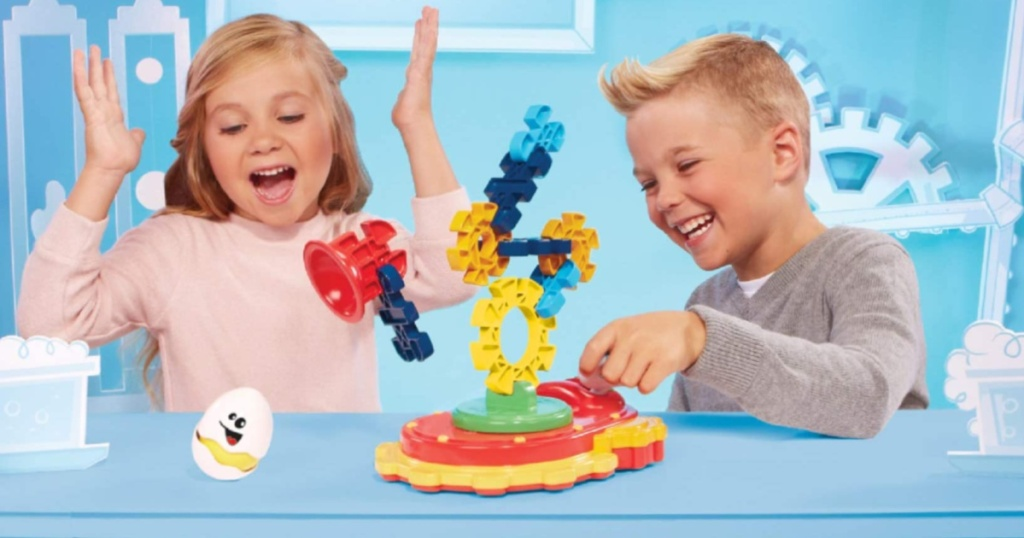 two children playing with Little Tikes Stem Quake Toy