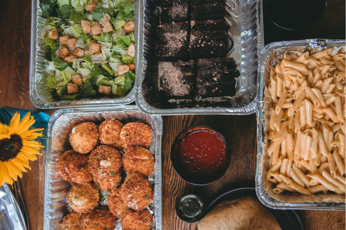 various trays of food on table