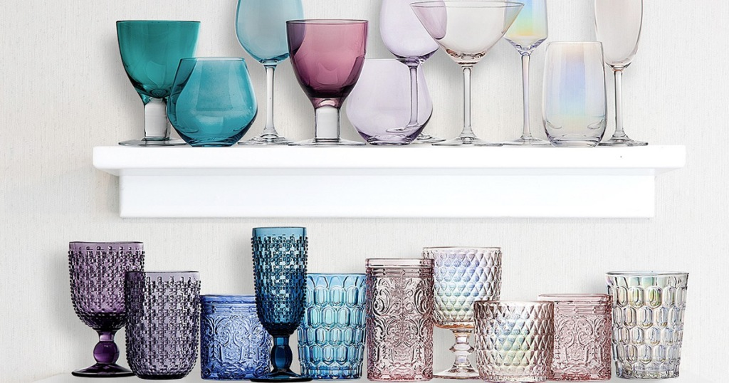 floating shelves on wall filled with various colors of different glassware