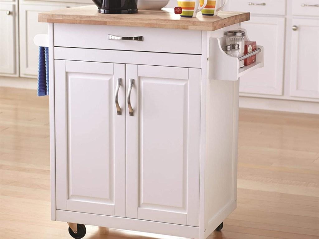 white kitchen island rolling cart in kitchen