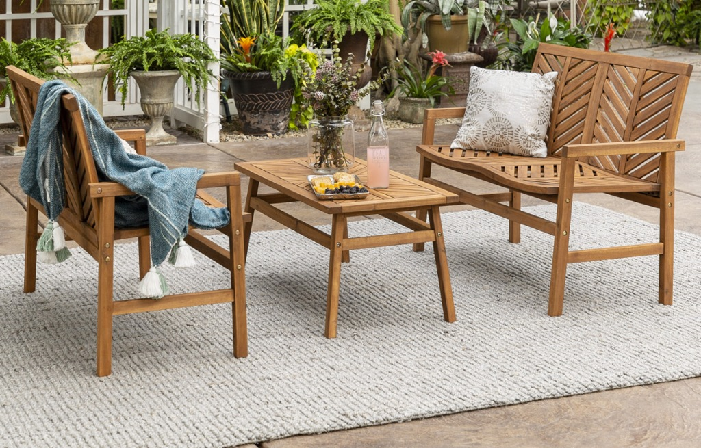 3-piece wood conversation patio set with two matching love seats and a coffee table