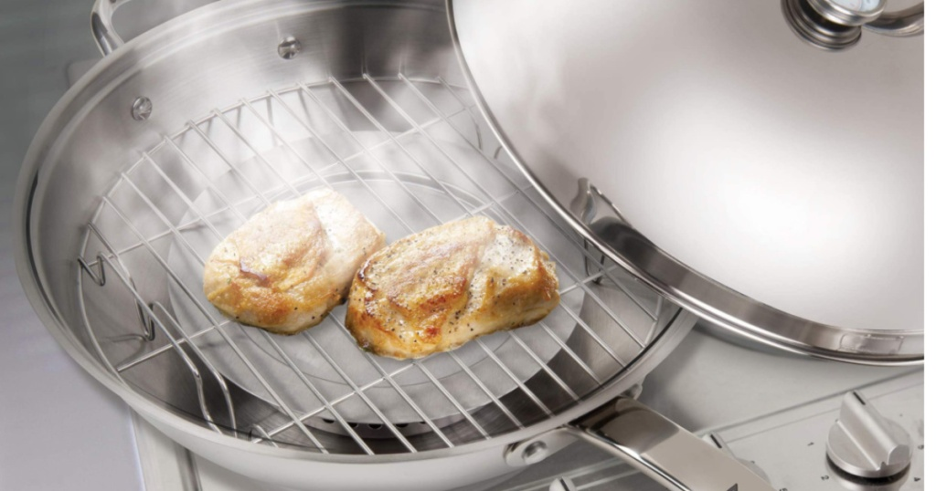stainless steel wok cooking chicken with the cover off