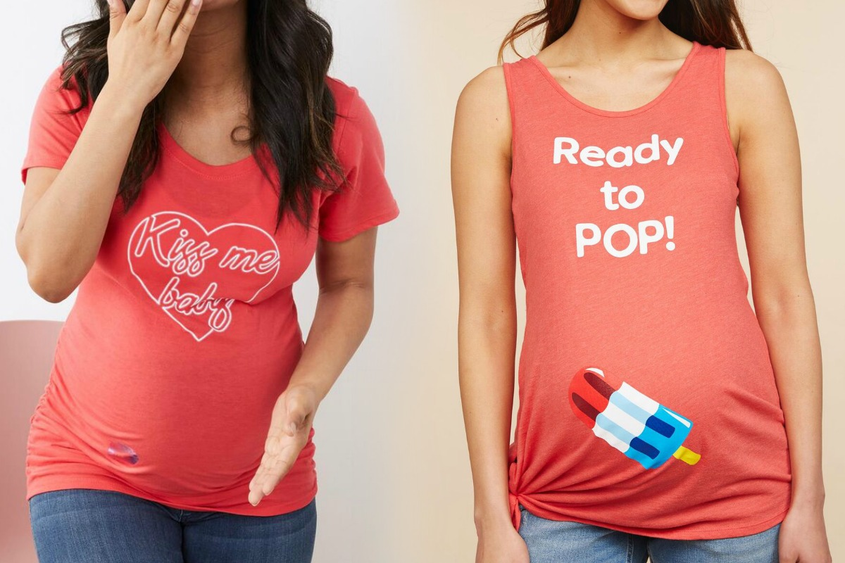 Two women wearing maternity shirts