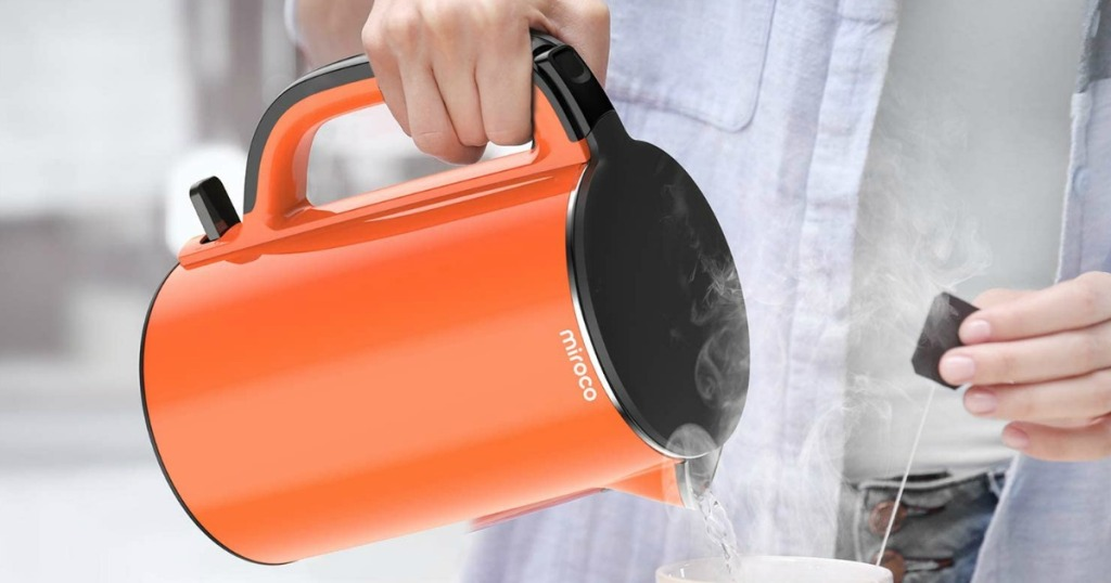 person pouring a kettle