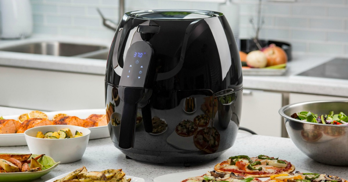 black air fryer surrounded by food