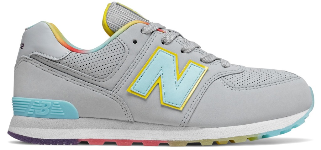 light grey new balance kids shoe with multi color sole