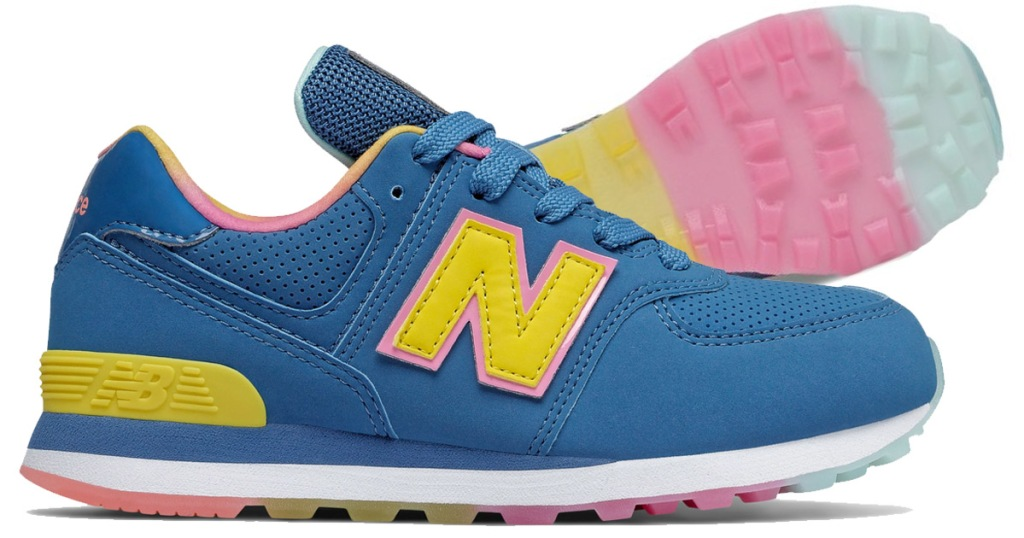 blue and yellow new balance kids shoe with multi color sole