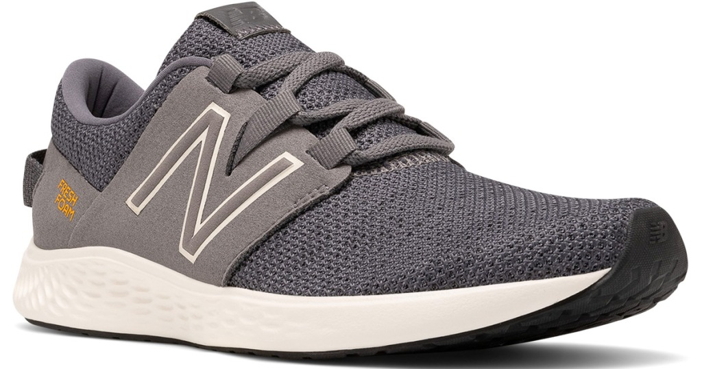 grey men's new balance running shoe with new balance logo on side and white foam sole