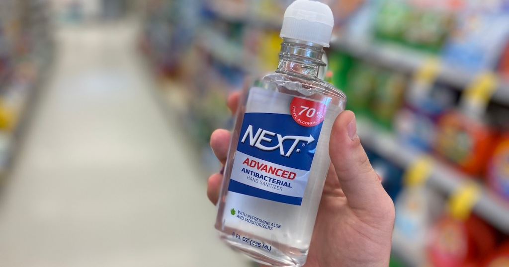 hand holding Next Advanced Antibacterial Gand Sanitizer