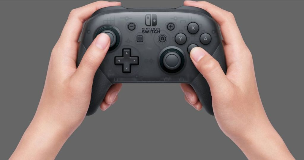 hands holding a wireless video game controller